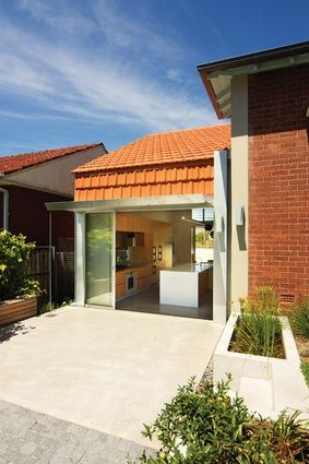 A Modern-Style Addition with Traditional Tile Roof — Welsh + Major Architects add to a bungalow in Sydney's heritage suburb of Haberfield.