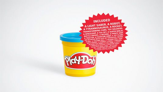 """AD ANALYSIS 7: The simple visual method of this ad for Play-Doh (a plain product shot and a sticker listing all the items """"included"""" in the jar) reinforces the message that the only limit to what Play-Doh can do is determined by the imagination and creativity of the user.  The ad appeals to a sense of adventure through humor."""