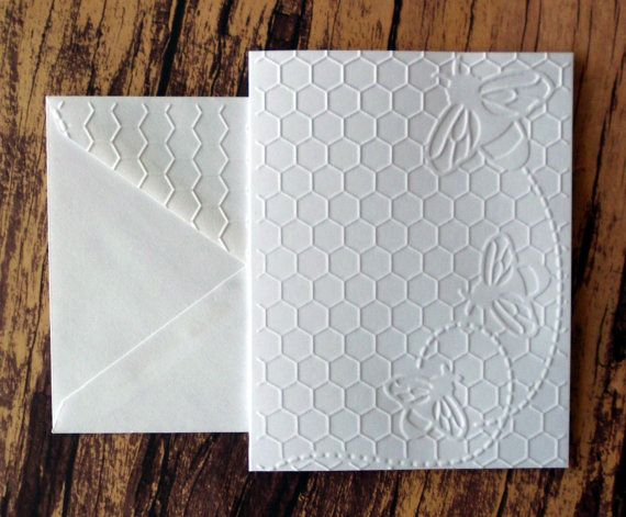 This listing is for 5 embossed Honeycomb with Bees cards and 5 white envelopes with matching embossed flaps. Card Size: Standard A2; 4.25 x 5.5. Card Base: White Neenah 110 lb. Cardstock. I used a paper trimmer, scoring board and bone folder to create each folded card base. Card Front: I placed the front of each card inside an embossing folder and hand cranked it through my embossing machine. Inside: Blank; white cardstock base. The back of the cards are blank. Cards/envelopes will co...