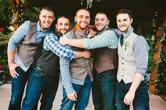Country Groomsmen Attire: For country weddings that embrace the rugged and rural, dress the fellas in mismatched wool tweed vests. With simple gingham shirts underneath and dark blue jeans, this is a great look for a rustic wedding party.