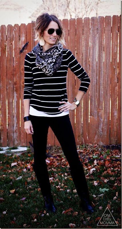 Black pants, striped shirt, patterned scarf.
