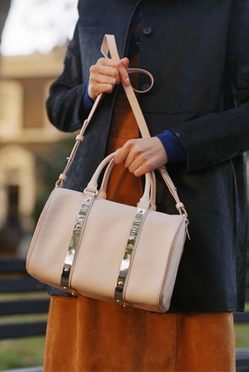 The Charlton shoulder bag in blossom pink is Sophie Hulme's take on the bowling bag. Note the signature polished hardware, supporting the structure of the stamped leather silhouette. The spacious interior will hold all your day-to-day essentials, zipped closed for security on the go. Carry via the top handles, or with the detachable strap.