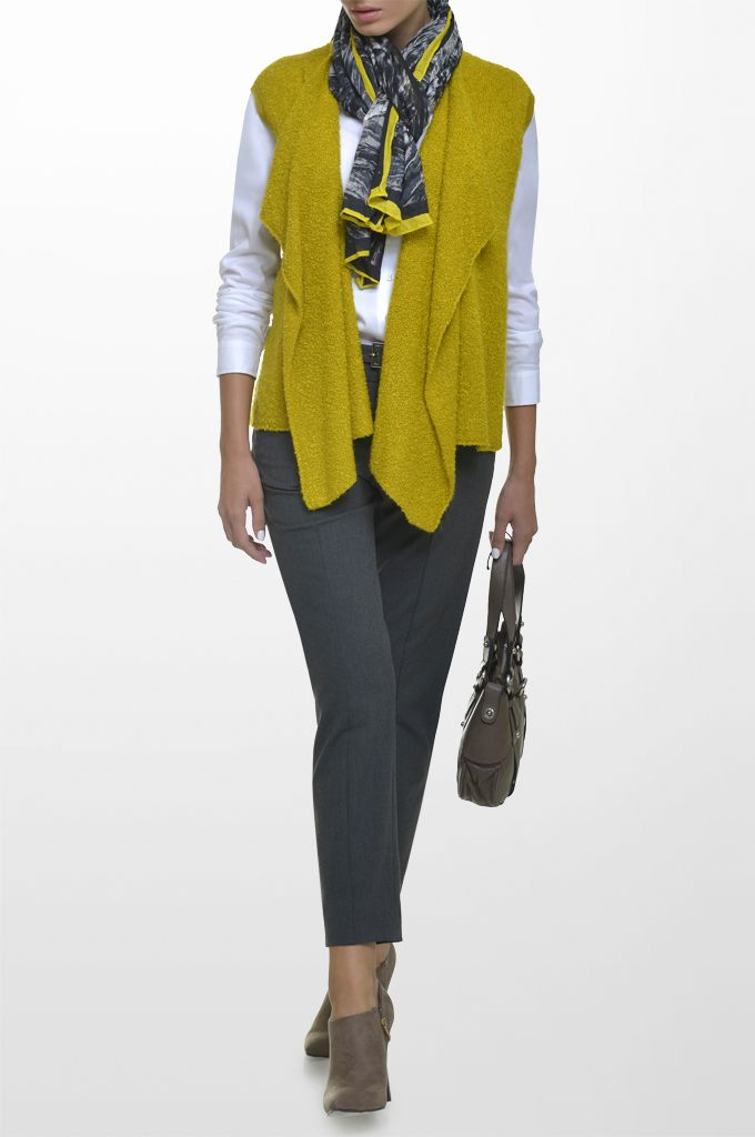 Sarah Lawrence - asymmetrical knitted vest, long sleeve shirt, cropped city pant with belt, printed scarf.