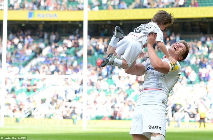 Farrell celebrates after helping his side to the Aviva Premiership title after guiding Saracens to victory