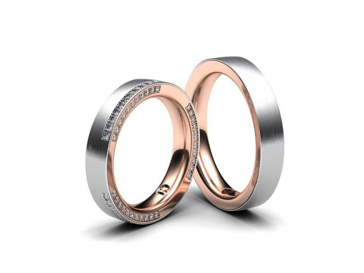 Jemné snubní prsteny vyrobeny v kombinaci bílého a červeného zlata. Pánský prsten bez kamene, dámský prsten je osazen 66 menšími kameny. Šířka prstenu 5 mm.