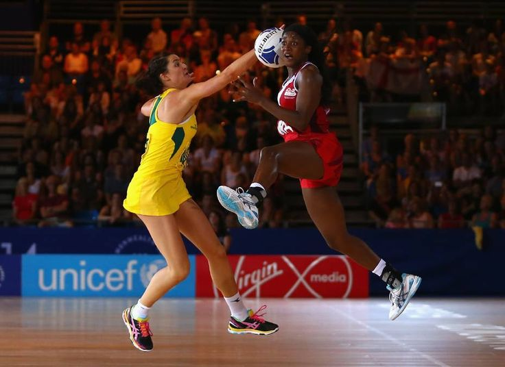 Sasha Corbin of England leaps for the ball in front of Australian Netball player - awesome play!