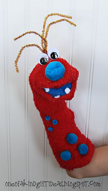 Monster Sock Puppets with pom poms and pipe cleaners for hair