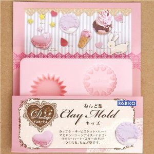 "mold for clay sweets for kids from Japan by Kawaii. $7.64. Use mold oil, Vaseline or Baby Lotion to grease the molds if you are using clay that tends to stick or has a stickier than usual texture, Dried clay can be lifted out of the mold with another piece of clay if necessary. pink plastic mold for soft clay for making children's favourite sweets, for muffin, heart cake, heart macaroon, heart, star, ice cream, ribbon and strawberry. diameter of the muffin: 3cm (1.1""), size ..."