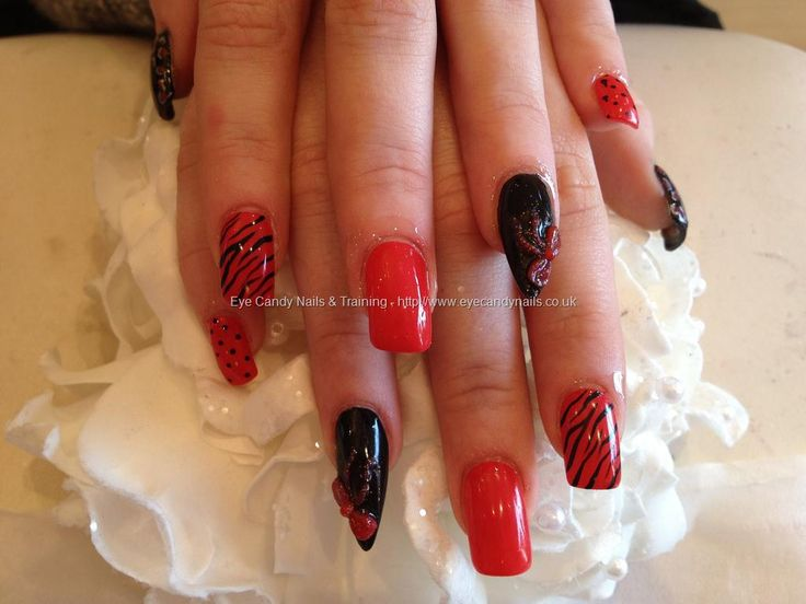 Red and black freehand nail art with 3d acrylic bows over acrylic square and stiletto nails