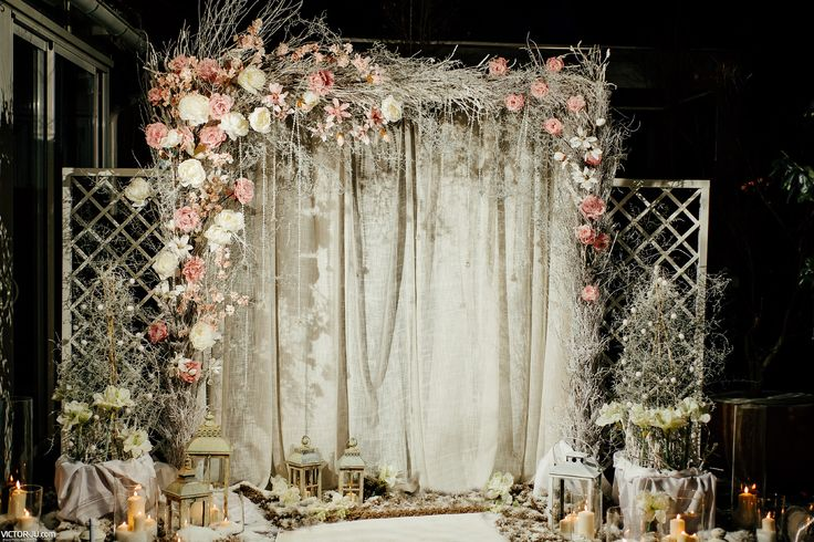 Winter style outdoors wedding decoration with roses and spray painted branches.