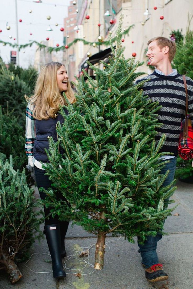 Picking out the Christmas tree together - Couple Christmas card picture inspiration