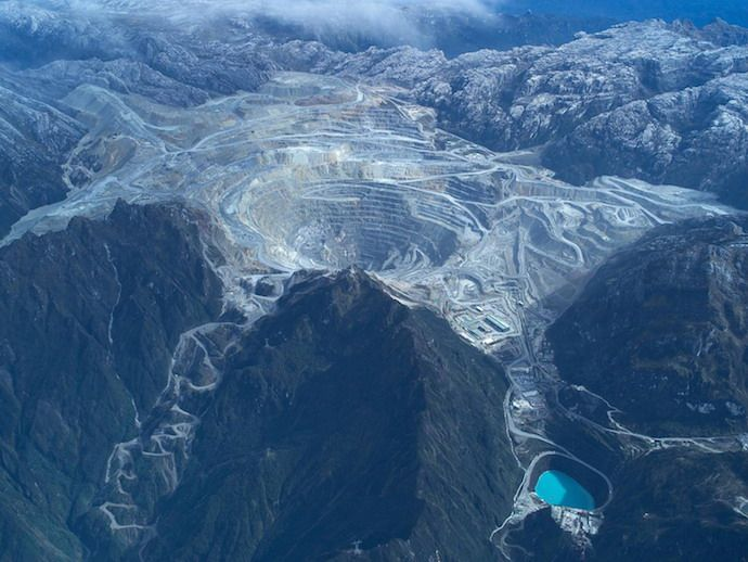 Grasberg Copper-Gold Mine, West Papua, Indonesia: discovered in 1988, today the Grasberg mining district contains the world's largest recoverable copper reserve and the largest gold reserve. The open pit mine forms a mile-wide crater at the surface.