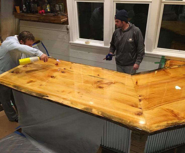 We eliminate the air bubbles by taking a blow torch and skim the top. This epoxy bar top is indestructible! #personalprideconstruction #mancave #homebar #epoxybartop #epoxy #rustic #modernfarmhouse #farmhouse #corrugatedmetal #personalprideconstruction #interiordesign #designdetails #dreamhome