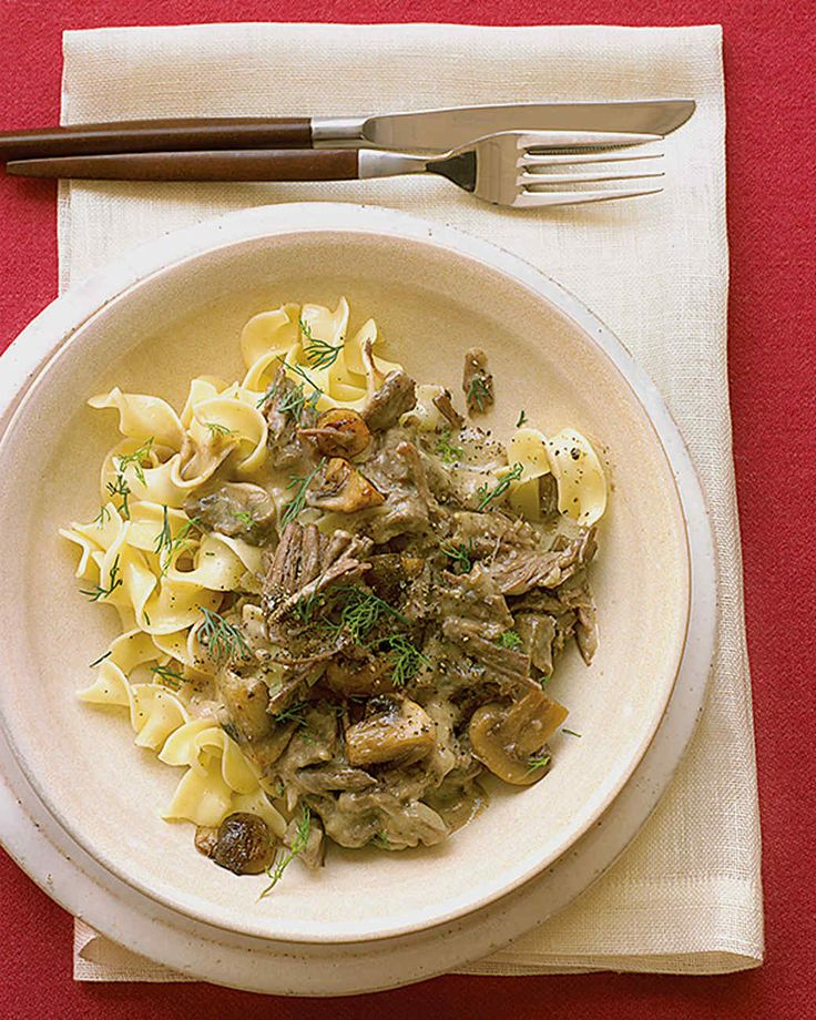 Beef Stroganoff | Martha Stewart Living - Use a slow cooker or Dutch oven to simmer sliced beef chuck with onion and mushrooms. Just before you're ready to serve the stroganoff, thicken the sauce with cornstarch and stir in sour cream and Dijon mustard.