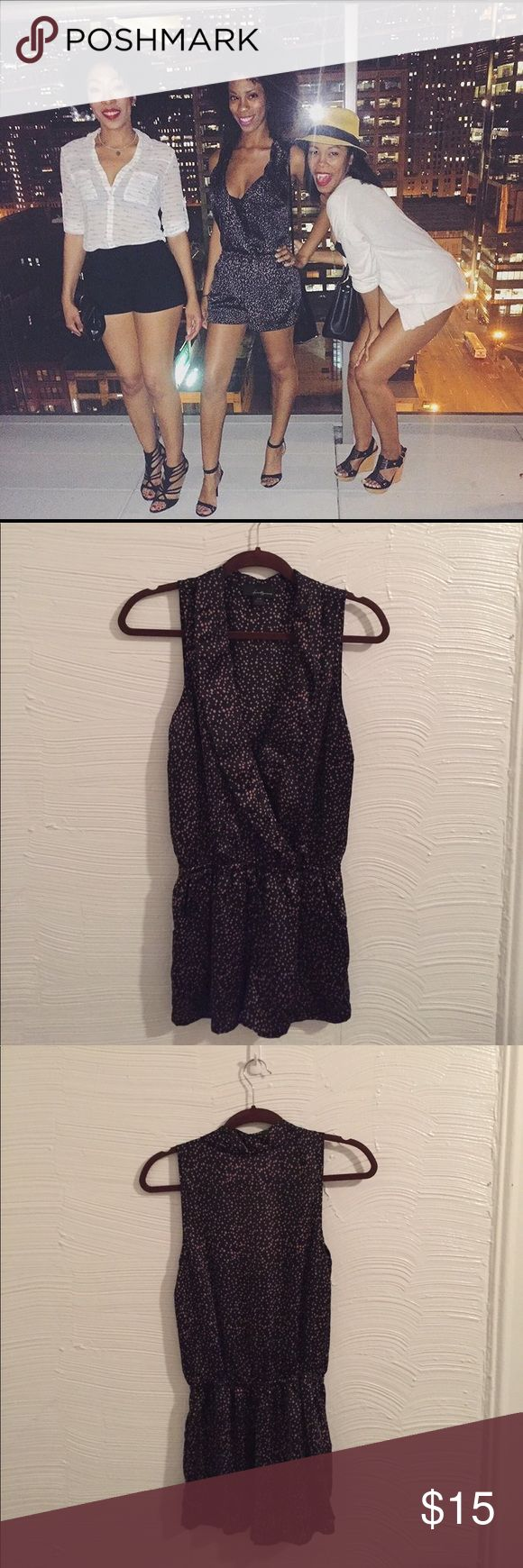 Polka dot romper Black and pink polka dot romper. Low cut in the front. A summer favorite. Forever 21 Pants Jumpsuits & Rompers