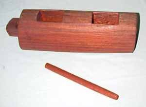 The Wooden Gong: This object is a musical instrument that produces different sounds and sends out different messages depending on how it is played, when it is played, and who played it.