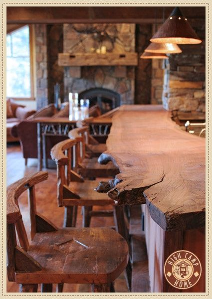 LOVE this rustic bar. this would be amazing for the party room! Rustic wood counter top.