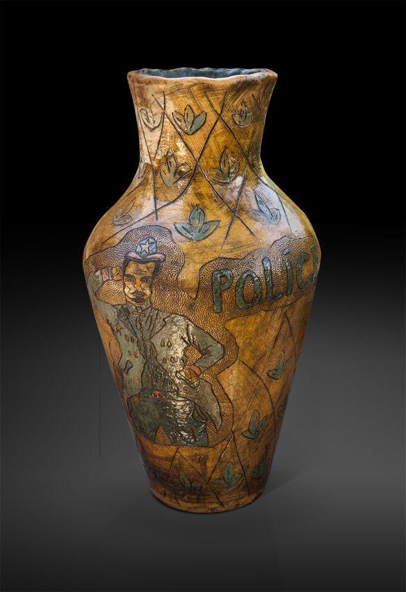 An original vase by Lucinda Mudge entitled: Police, ceramic, h 52cm For more please visit www.finearts.co.za