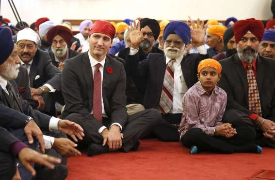 Canadian Prime Minister Justin Trudeau listens to speeches at the Gurdwara Sahib Ottawa Sikh Society... - REUTERS/Patrick Doyle