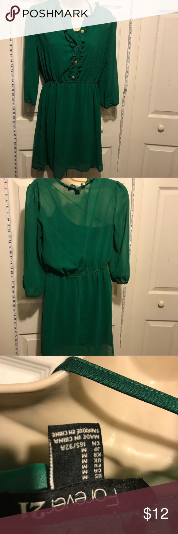 30% Off Bundles Emerald Green Chiffon Dress Gold buttons! Dress has a liner dress underneath. Great condition. No marks or stains. Add three more items to your bundle for 30% off. Forever 21 Dresses