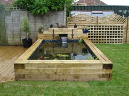 Raised garden ponds google search backyard pinterest for Raised koi pond ideas