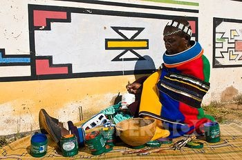 Africa | Artist Francina Ndimande painting the walls of her house.  Mabhoko Village, KwaNedbele, Mpumalanga Provice, South Africa | ©Photononstop