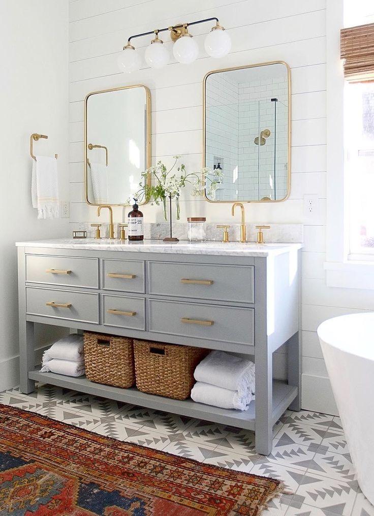 Bathroom with dual sink vanity and the Bistro Four Light Bath Sconce by Ian K. Fowler. Interior design and by @amylindinteriors.
