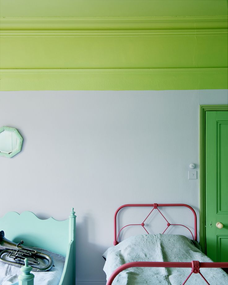 Farrow  Ball's Calluna on wall, Churlish Green ceiling, Folly Green door, Cooking Apple Green architrave, Parma Gray left hand bed, Red Earth right hand bed.