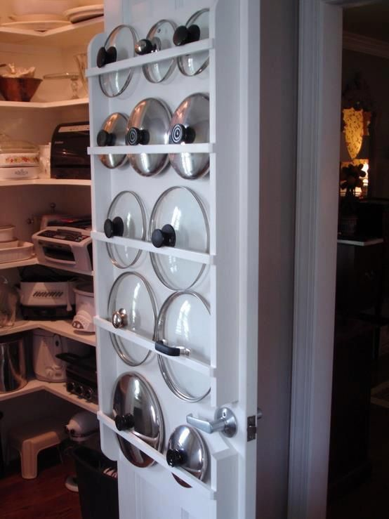 Great idea for a pot and pans Lid Storage system in kitchen...love this!  Wish I had a pantry...