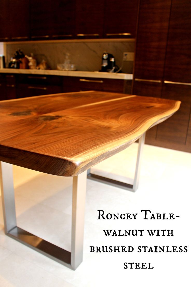 black walnut table with stainless steel base