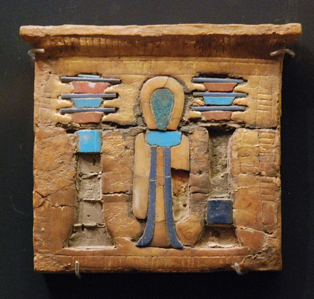 Glided and entrusted wooden pectoral; symbols of the god Osiris and goddess Isis; Ancient Egypt, about 1400 - 1100 BC.