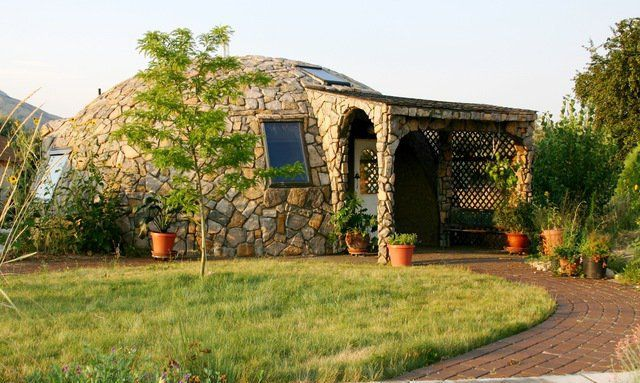 Image: 800-square-foot, spectacular, small home in Brigham, Utah. No A/C needed. Open windows at night to cool it. It stays cool all day. Owner Lori Hunsaker did the rock cover on the exterior herself.