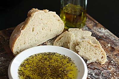 Johnny Carinos Olive Oil Dip  1 cup extra virgin olive oil  2 teaspoons rosemary  2 teaspoons parsley  2 teaspoons oregano  1 teaspoons crushed red pepper  1 teaspoon salt  1 teaspoon black pepper  4 teaspoons Parmesan cheese  1 head garlic peeled and chopped