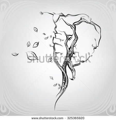 Silhouette of the head of an elephant from trees