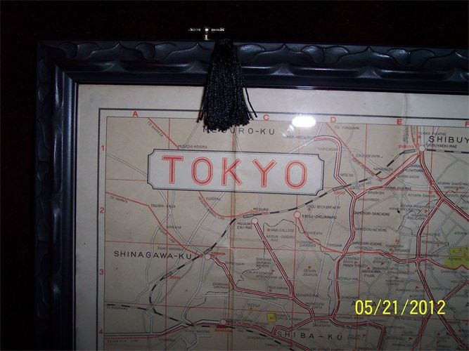 RARE WWII SURVIVOR. 1939 Tokyo Tourist Map in English Showing Central Wards of the City. Double sided plexiglass custom frame.  Sightseeing tips, including European restaurants. $850.00.