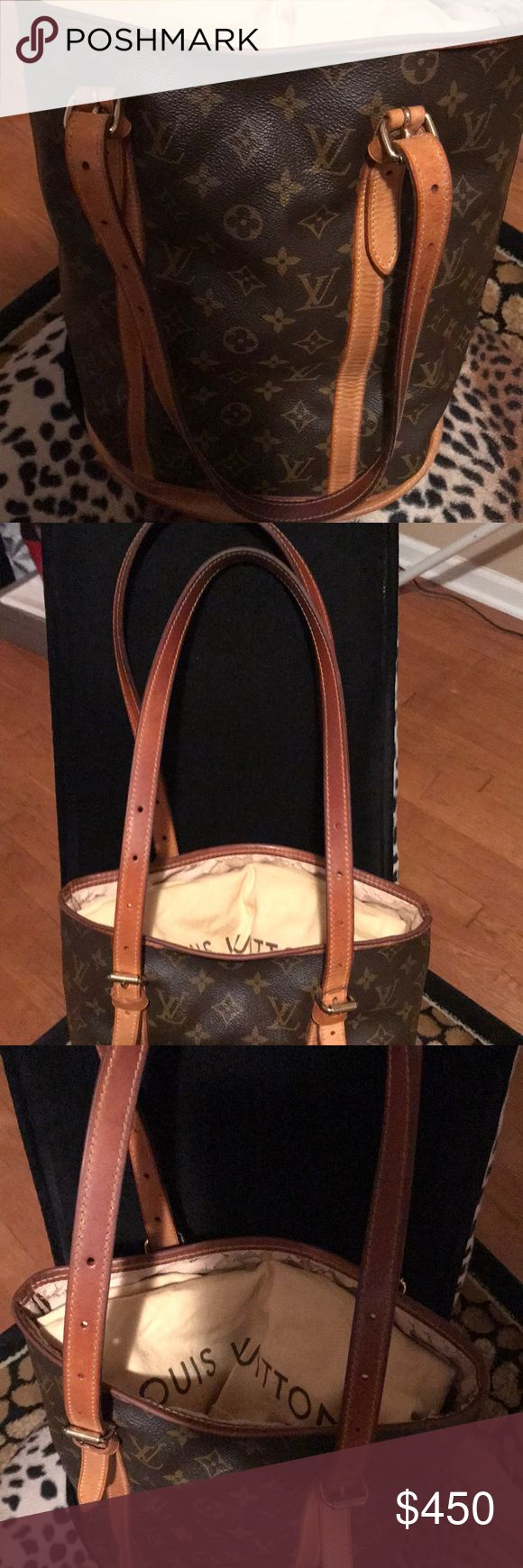 Vintage LV Large bucket handbag 100% Authentic!!  Vintage bucket bag. Wear on the inside of the rim bad. Otherwise great condition. Louis Vuitton Bags Shoulder Bags