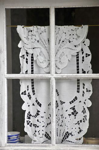 Great way to display vintage lace.... For a little while-- would have a concern for sun damage if in window too long.