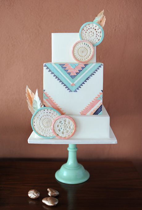 Brides.com: . A set of vintage mugs depicting Southwestern patterns and imagery became the inspiration for this wedding cake, created by Avalon Cakes, decorated with bohemian elements like handmade sugar dream catchers and wafer-paper feathers.   $9.50 per slice, Avalon Cakes