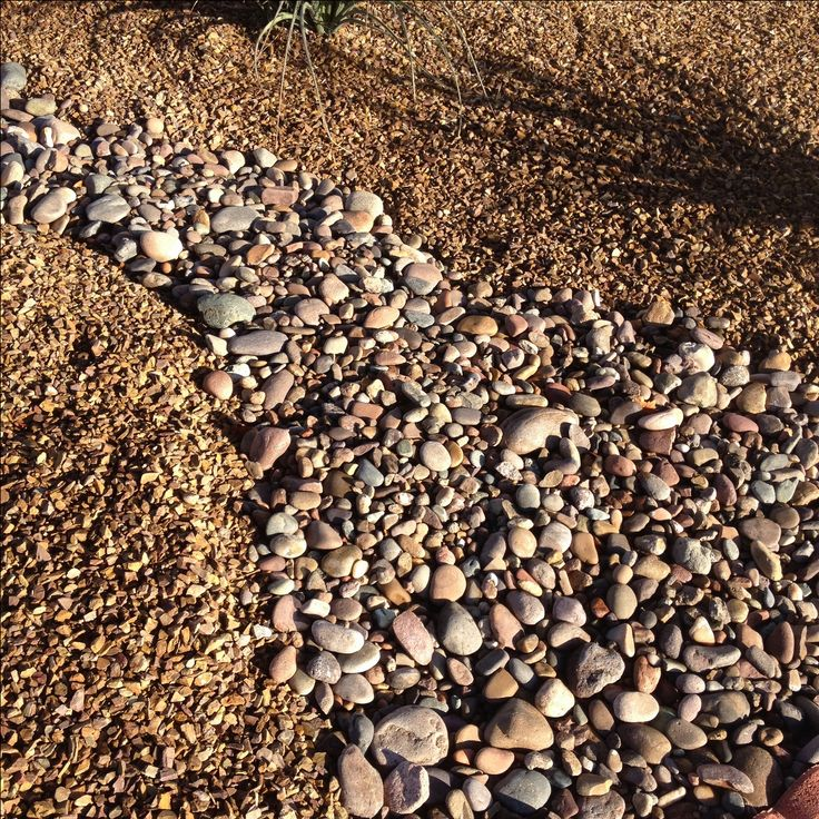 """Apache Brown Rock Gravel 5/8"""" with Arizona River Rock. Very good contrasting textures with complimentary colors combining for a natural look.http://www.earthstonerock.com/Apache-Brown-Landscape-Gravel-Prices-s/585.htm"""
