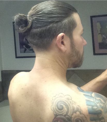 A cool man bun undercut seen from behind