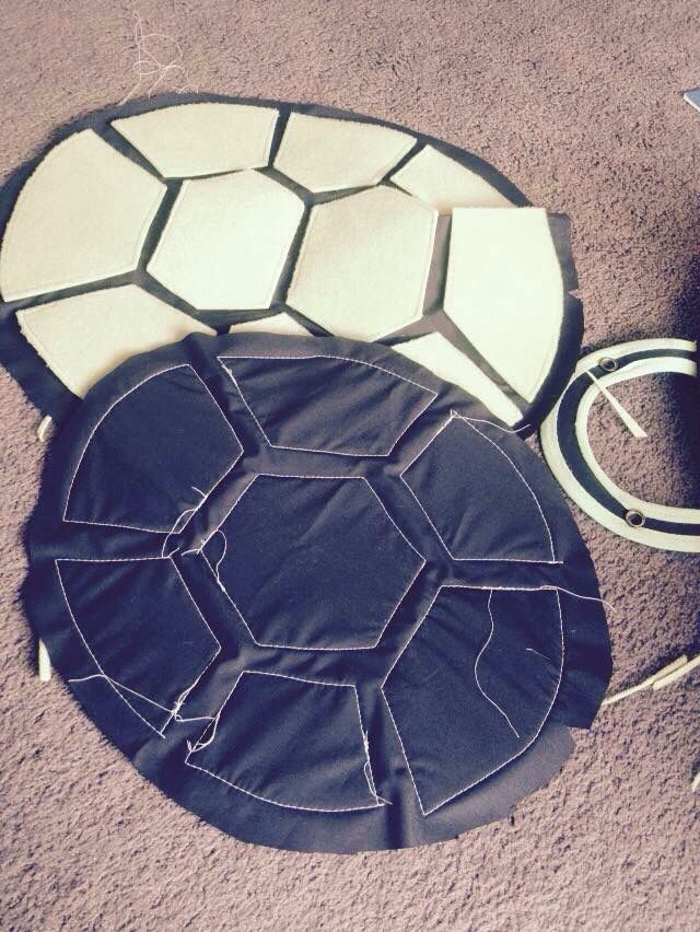 Ninja turtle shells in progress for my 2 children. (Black material & green felt)