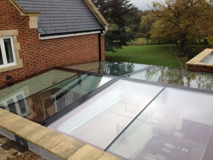 Dual pitched structural glazed rooflight with internal glass fin supports