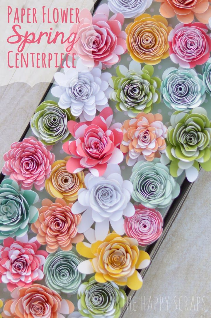 Paper Flowers cut with the Cricut Explore to make this Spring Centerpiece. Learn how to make it at www.thehappyscraps.com