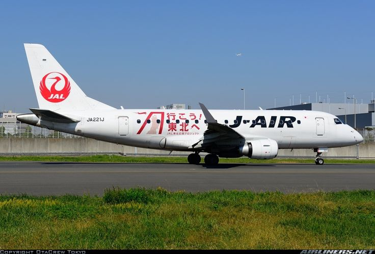 J-Air (JP) Embraer ERJ-170 JA221J aircraft, with a sticker promoting tourism for the earthquake stricken area of Tohoku on the fuselage & the ''Tsurumaru=Crane circle'' livery, skating at Japan Tokyo Haneda International Airport. 19/10/2014. (Tohoku=a region at northeastern portion of Honshu. At 11/03/2011 a 9.00-9.01 magnitude earthquake & tsunami hited the region).(J-Air=a wholly owned by JAL Airlines company).