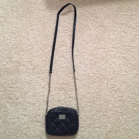 Michael Kors mini crossbody Black quilted Michael Kors crossbody with leather and chain strap. Will fit an iPhone 6/6s. Great to use at night! Michael Kors Bags Crossbody Bags