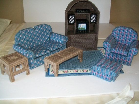 Barbie Fasion Living Room Set.  This set includes the following, couch with removable cushions, chair with removable cushions, wall unit with doors that open and close, coffee table, inn table, tv, dvd player with speakers, mat, and ottoman with removable cushion.