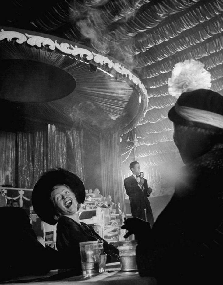 Singer Rudy Vallee in a nightclub, New York, 1949 by Cornell Capa