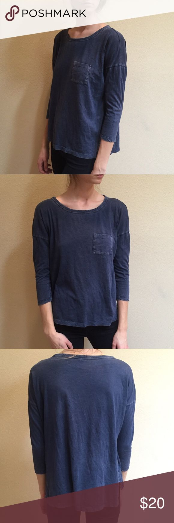 """🌵 NEW LISTING! 🌵 GAP Blue """"Denim"""" Tee Cute blue """"denim"""" looking tee with 3/4 length sleeves. Great if you're going for the slouchy look. A couple tiny holes that are barely noticeable at the bottom on the front. Happy to answer any questions! GAP Tops Tees - Short Sleeve"""