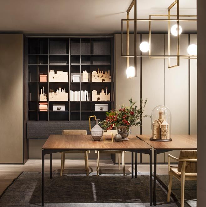 Piero Lissoni, our art director, signs LUCE, table with bronze coloured metal structure here showed for the first time and HATI with shapes that are reminiscent of some past chairs, reworked to highlight structures and enhance its proportions. Made-to-measure SELECTA bookcases by Officinadesign Lema is made in Carbon oak and is characterised by the mix of backs in wood and fabric. Lema S.p.A. Salone del Mobile, Design Week 2016