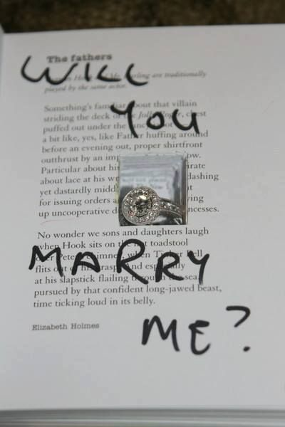 Amazing proposal idea, inside her favorite book. <3